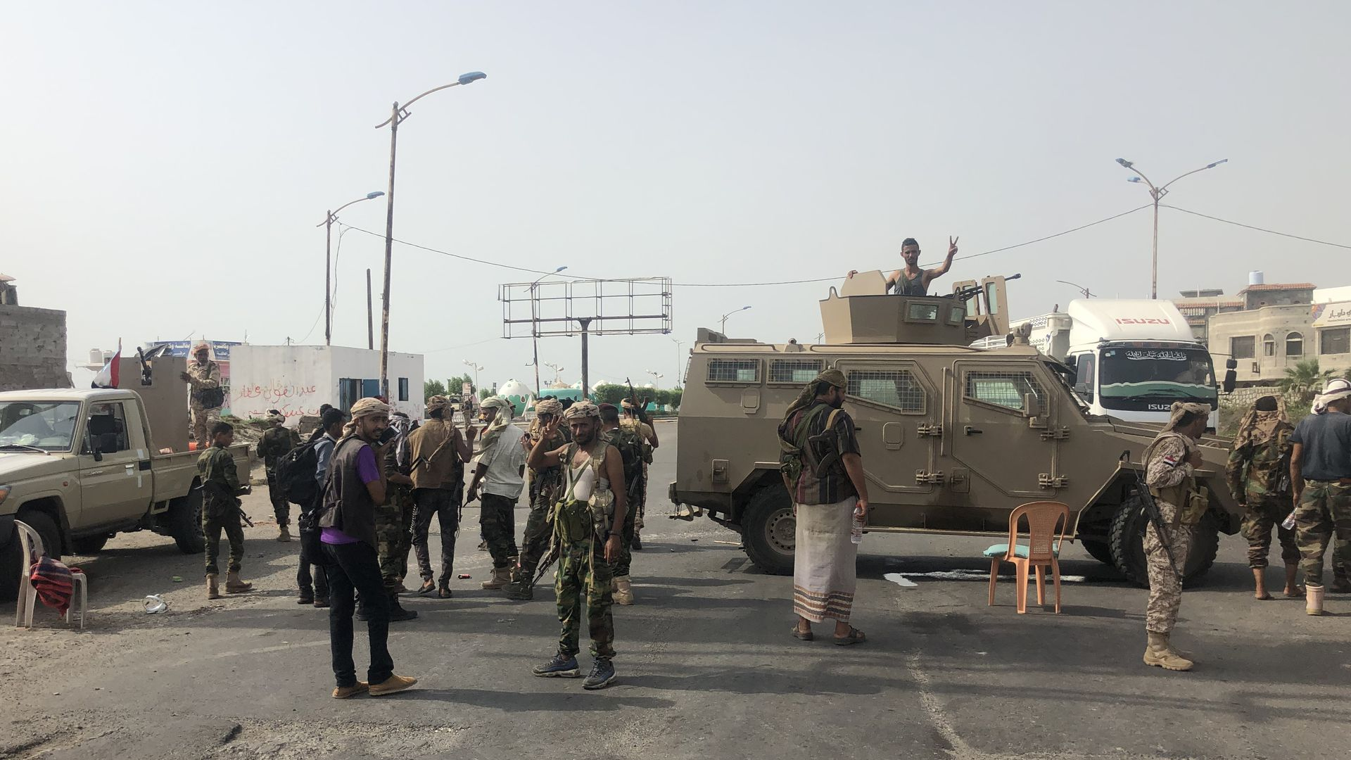 separatist security forces with military vehicles in the middle of a road
