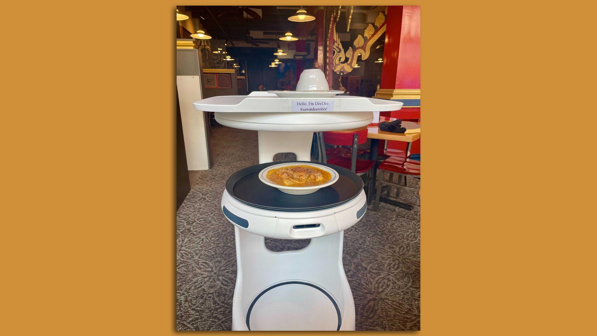 DeeDee, Minnesota's first robot server, delivers curry at Sawatdee in Minneapolis.