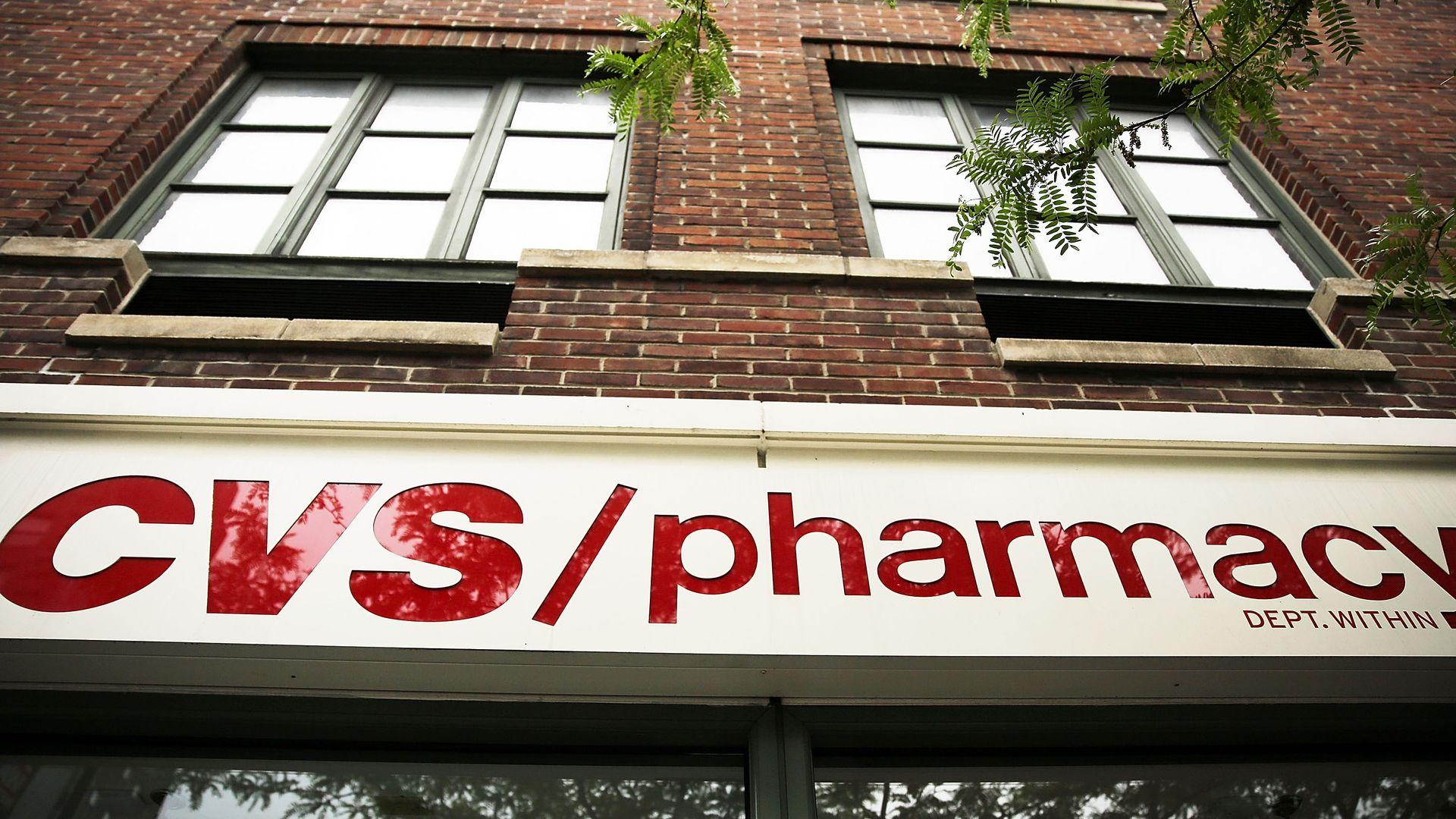 The CVS pharmacy logo on a storefront.