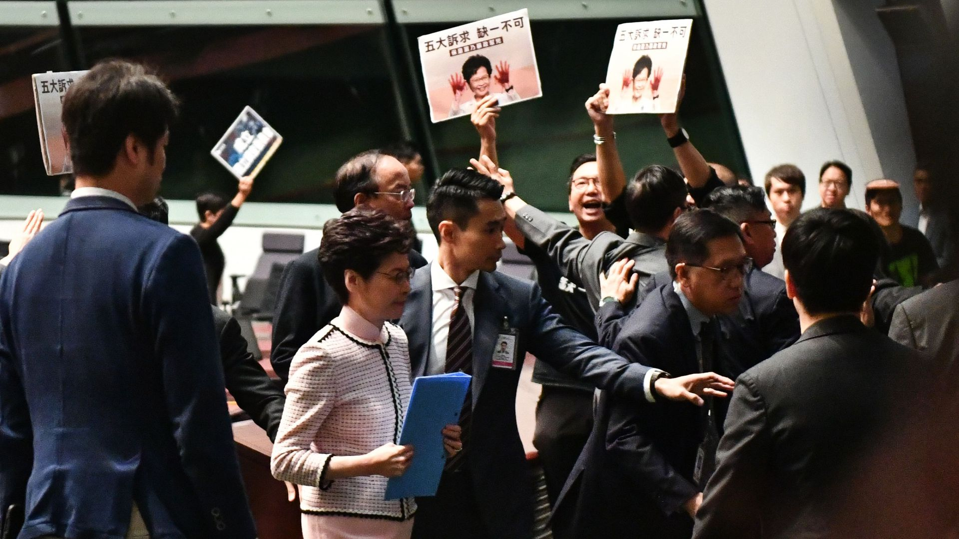 Hong Kong's Chief Executive Carrie Lam  leaves the chamber after trying to give her annual policy address