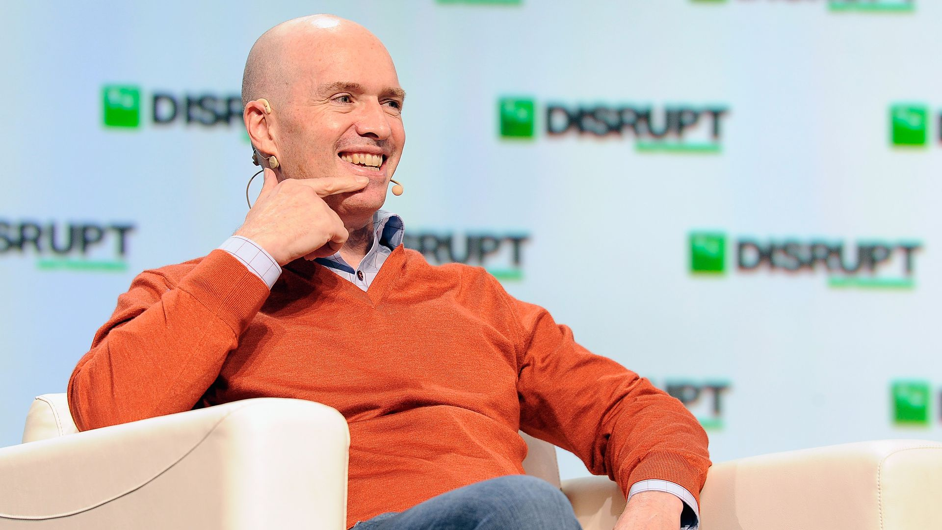 In this image, Andreessen Horowitz sits in a chair and speaks.