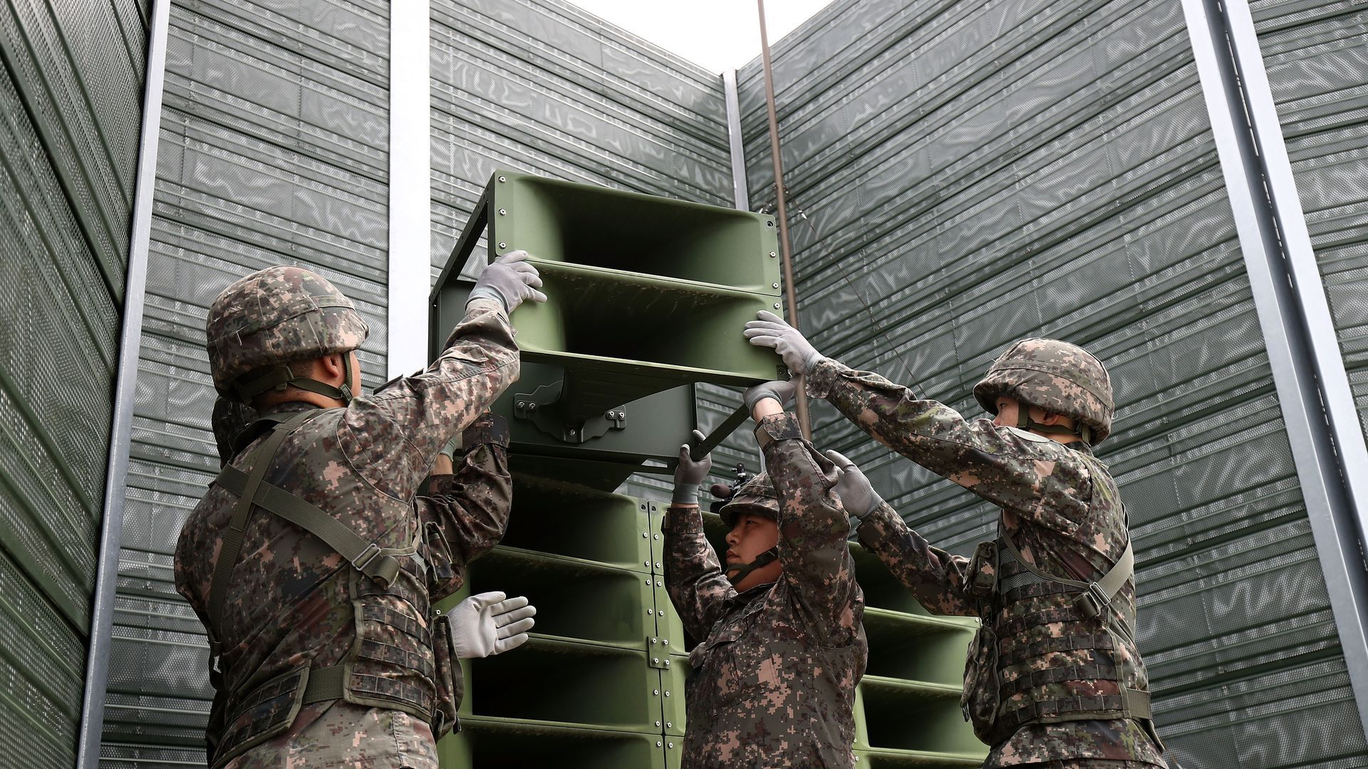 South Korean soldiers removing propaganda speakers