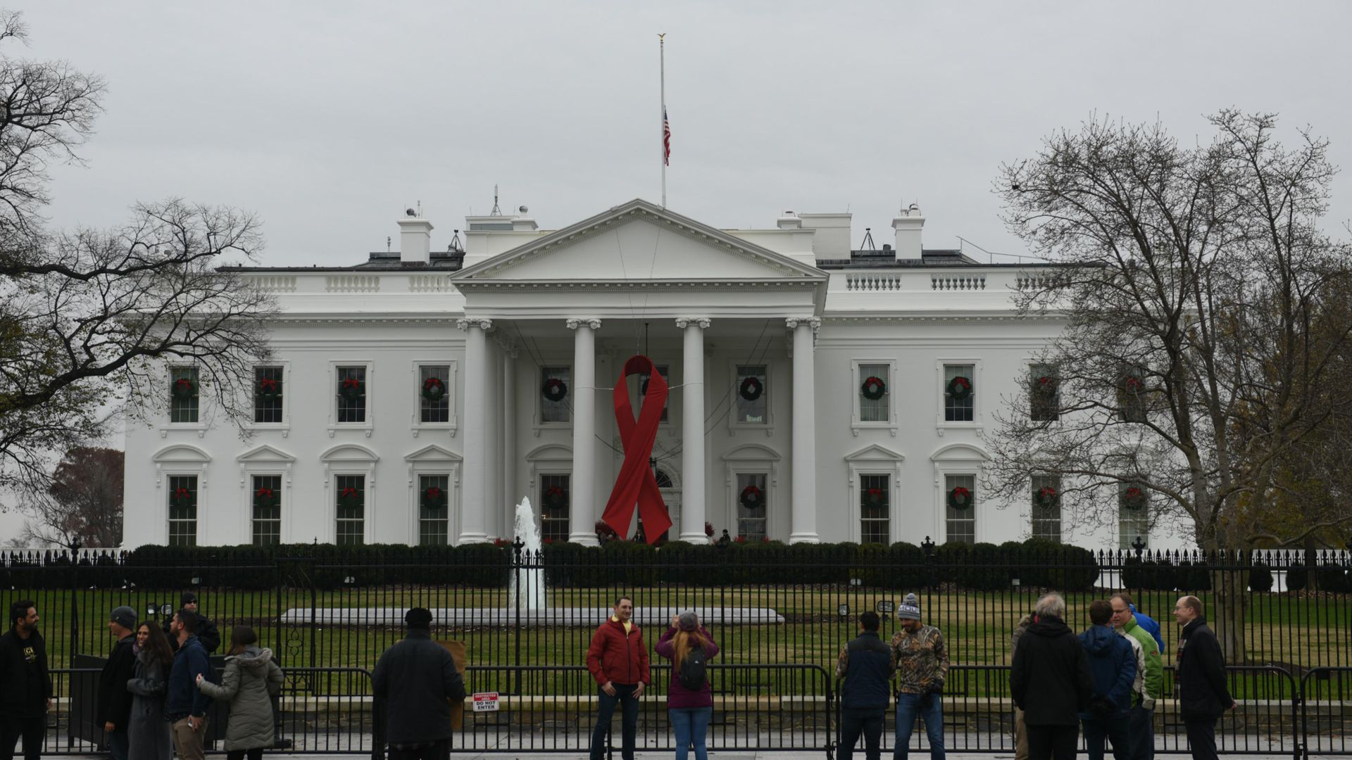 White House with Red ribbon on the front for world aids day