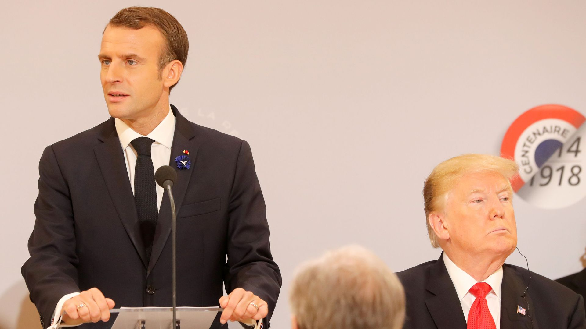Photo of Trump and Macron looking in opposite directions.