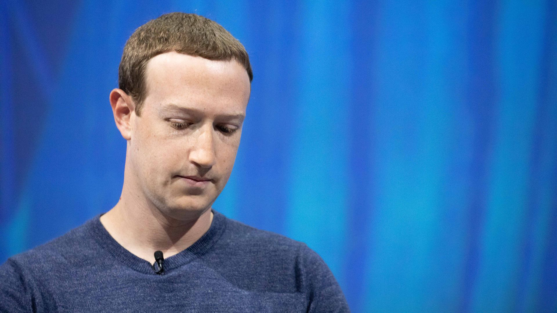 Mark Zuckerberg, eyes cast downward