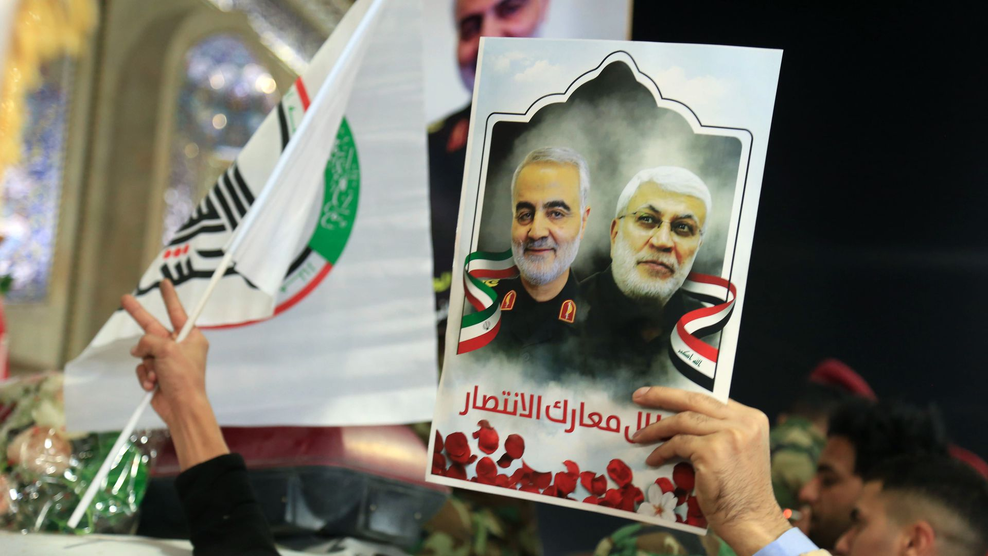 Mourners take part in the funeral procession of slain Iranian General Qasem Soleimani