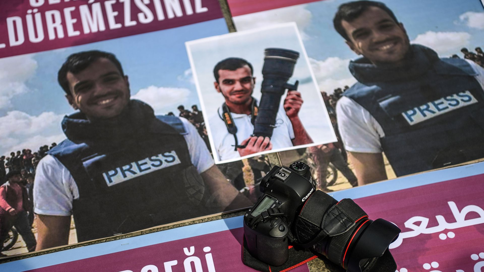 People take part in a protest against the killing of a fellow journalist Palestinian Yasser Murtaja