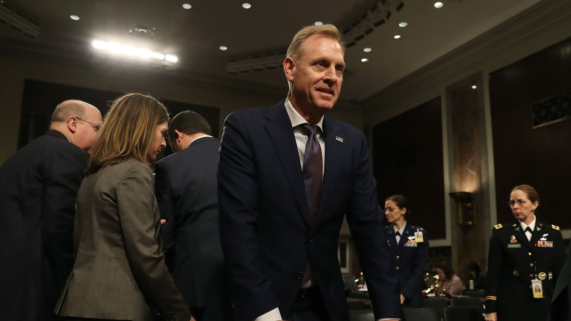 Acting Defense Secretary Patrick Shanahan stands behind the witness table at a congressional hearing