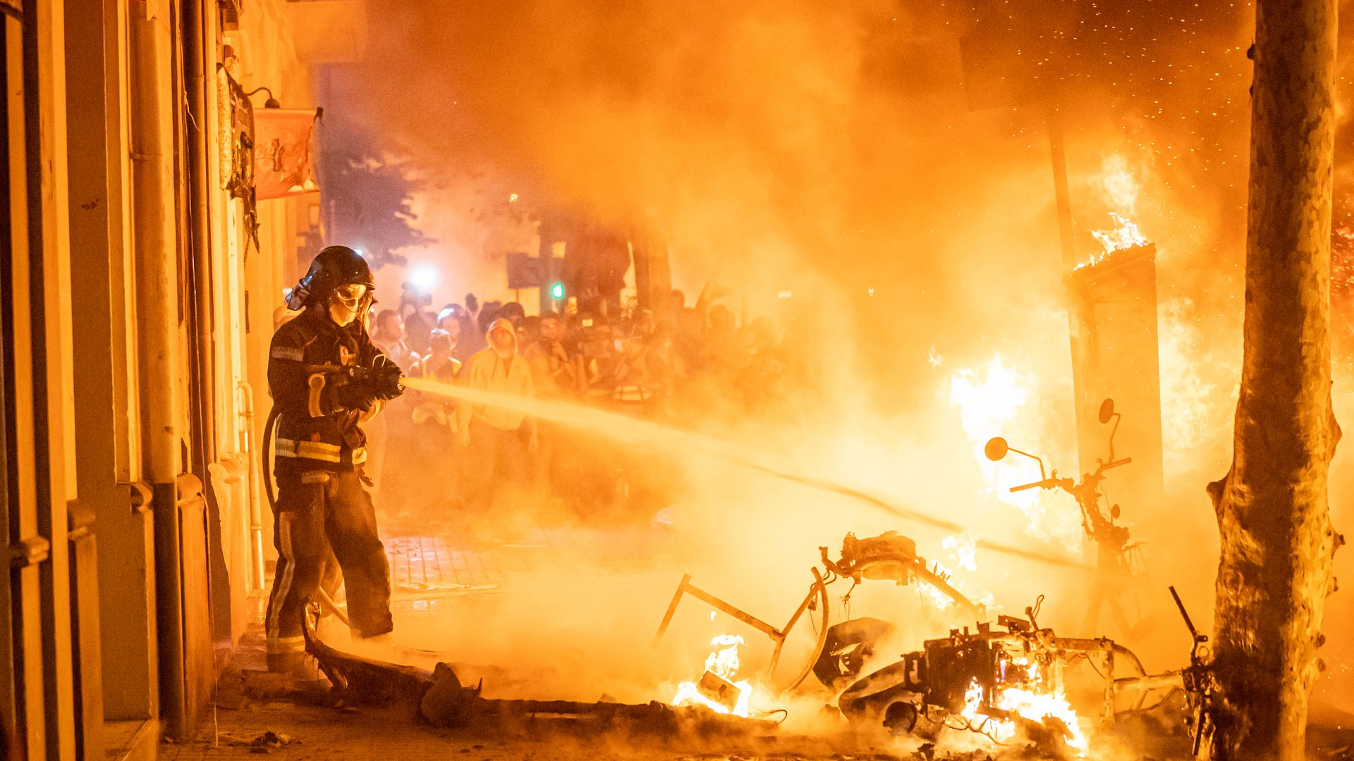 Barcelona firefighters put out fires during protests on October 16, 2019 in Barcelona