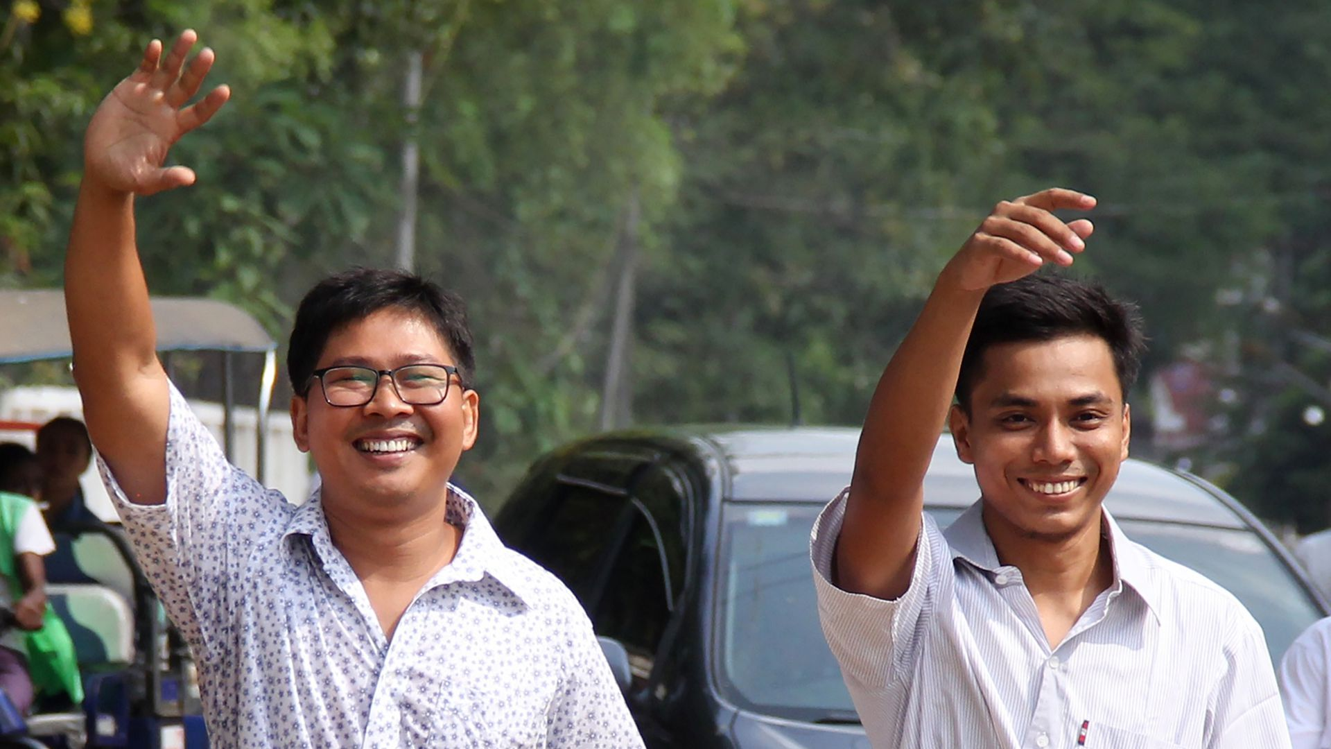 Reuters journalists Wa Lone (L) and Kyaw Soe Oo gesture outside Insein prison after being freed in a presidential amnesty in Yangon on Tuesday local time.
