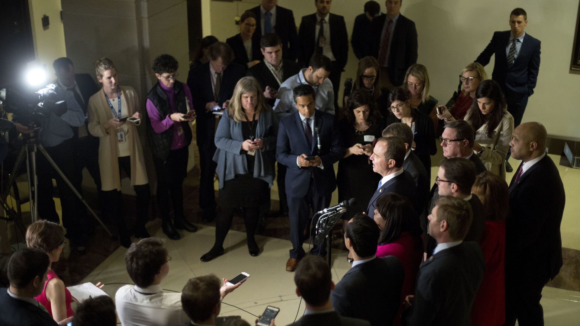 Photo of Rep. Adam Schiff, surrounded by media