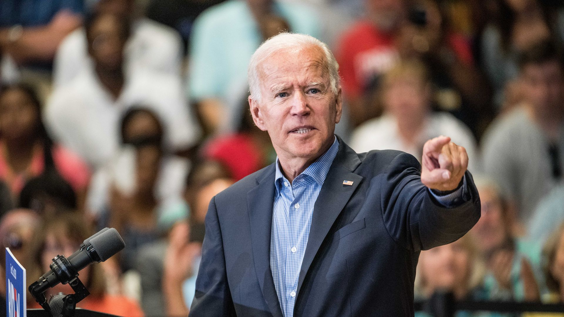 Joe Biden giving a speech, making a dramatic gesture, with the crowd behind him.
