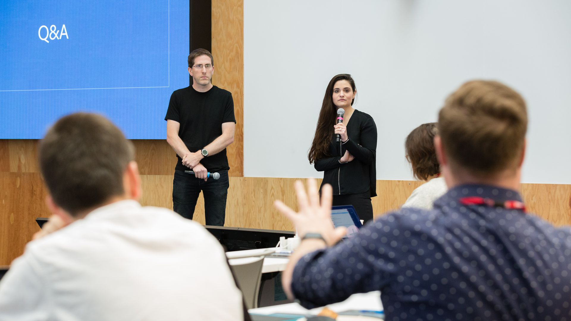 Facebook's Guy Rosen and Tessa Lyons answer reporters' questions during a presentation on efforts to fight misinformation.