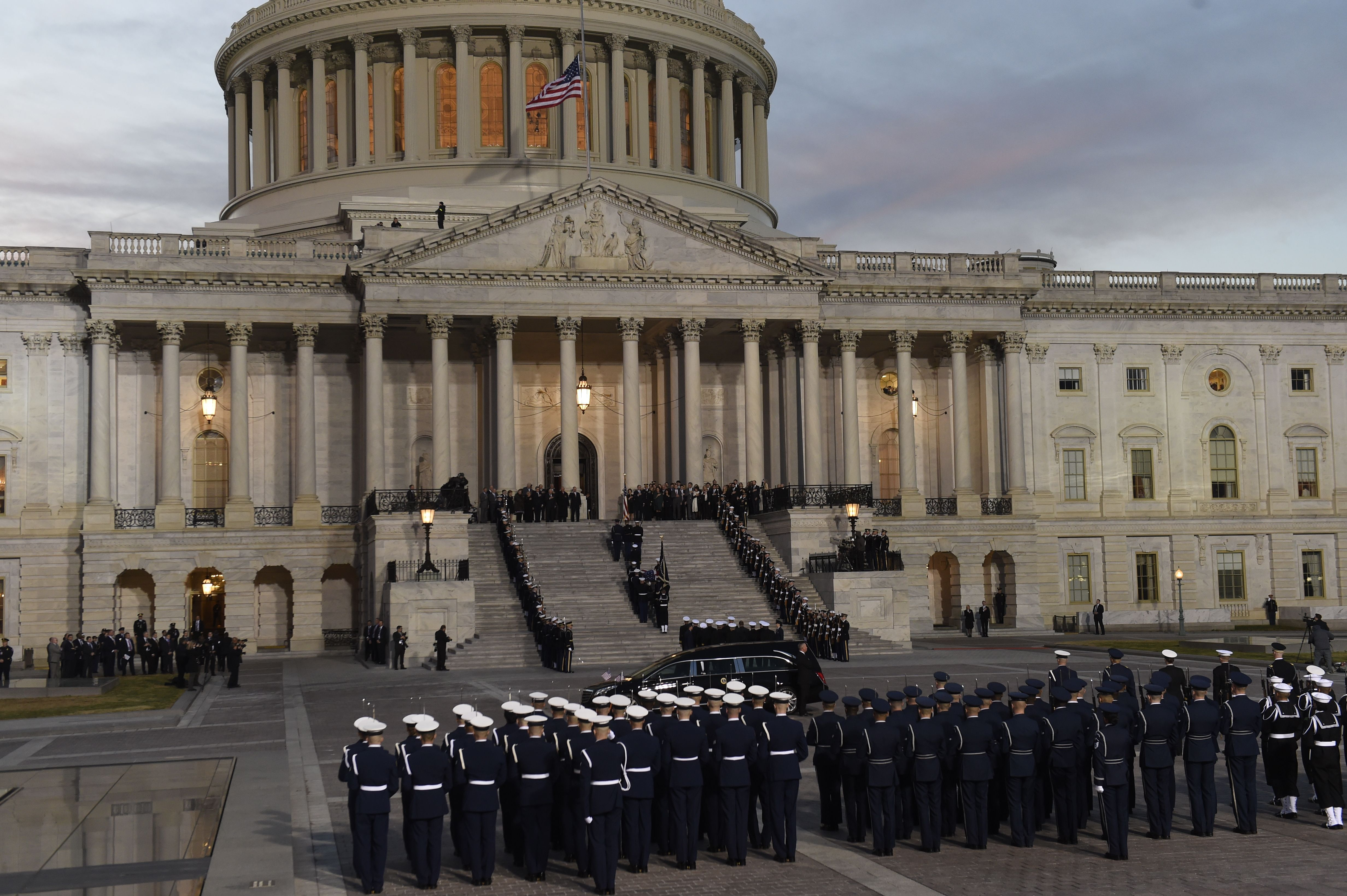 George H. W. Bush's casket is carried up the steps of the Capitol.
