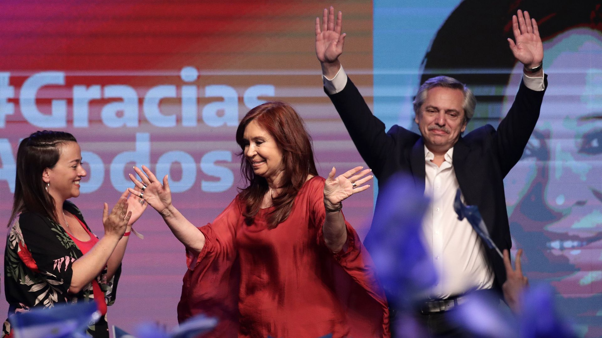 Alberto Fernandez and Cristina Fernandez de Kirchner on stage celebrating victory