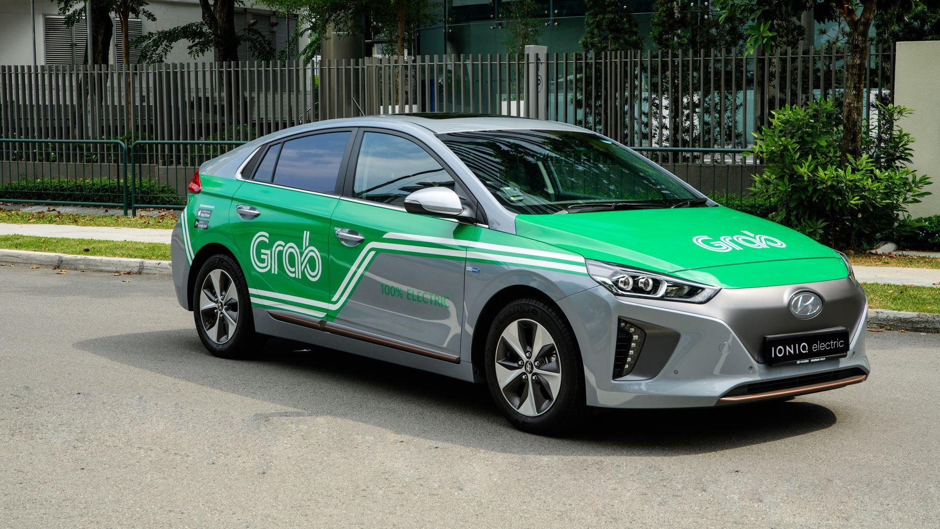 Photo of electric Hyundai car with Grab logo.
