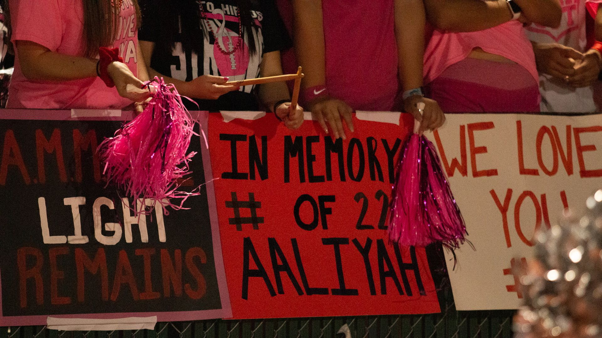 Poster in memory of Aaliyah Marie Martinez at a Hutto football game.