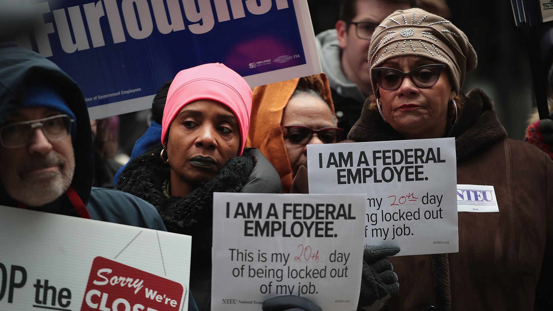 Government workers protest the government shutdown during a demonstration in the Federal Building Plaza last week in Chicago, Illinois.