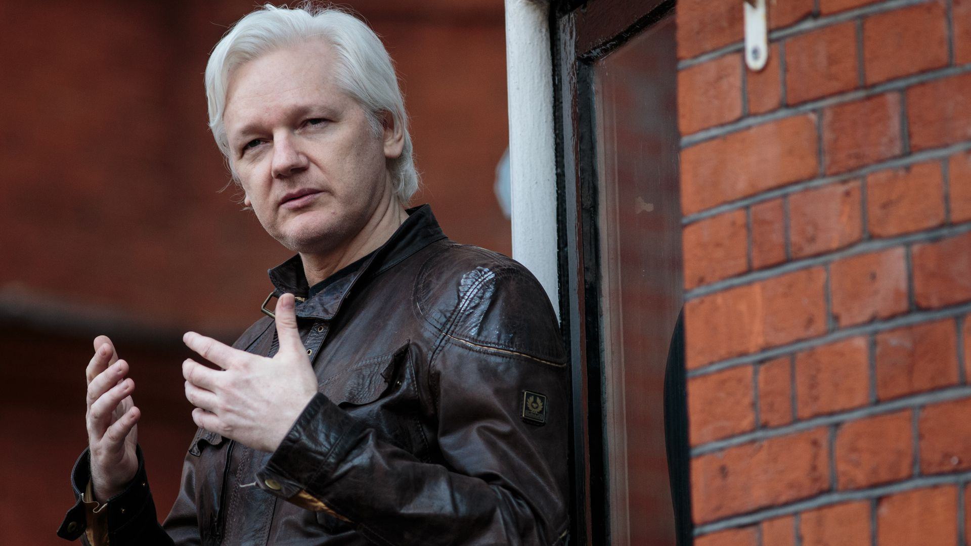 Julian Assange speaking to the media
