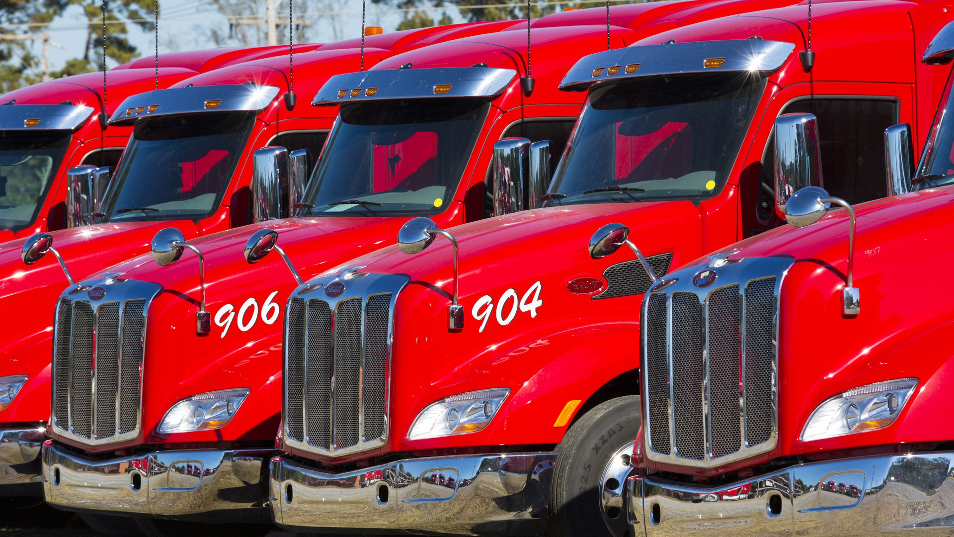 Red engines and cabs of big trucks.