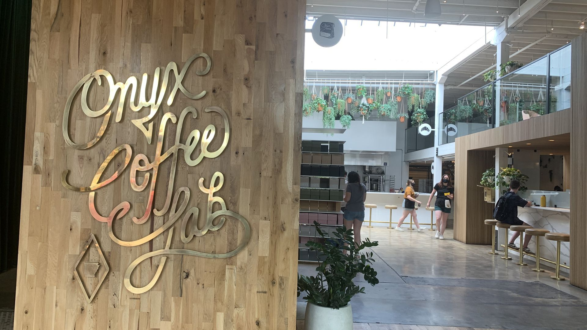 The entrance to Onyx Coffee Lab, with a large stylized sign showcasing the business' name.