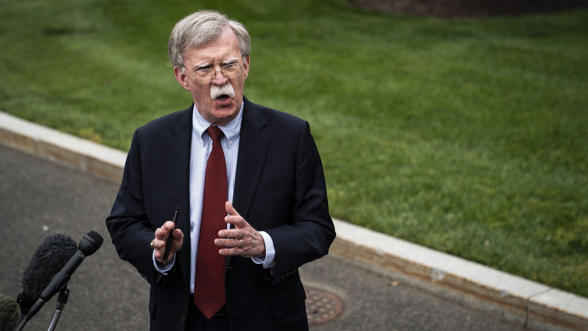 John Bolton speaking to press outside the White House