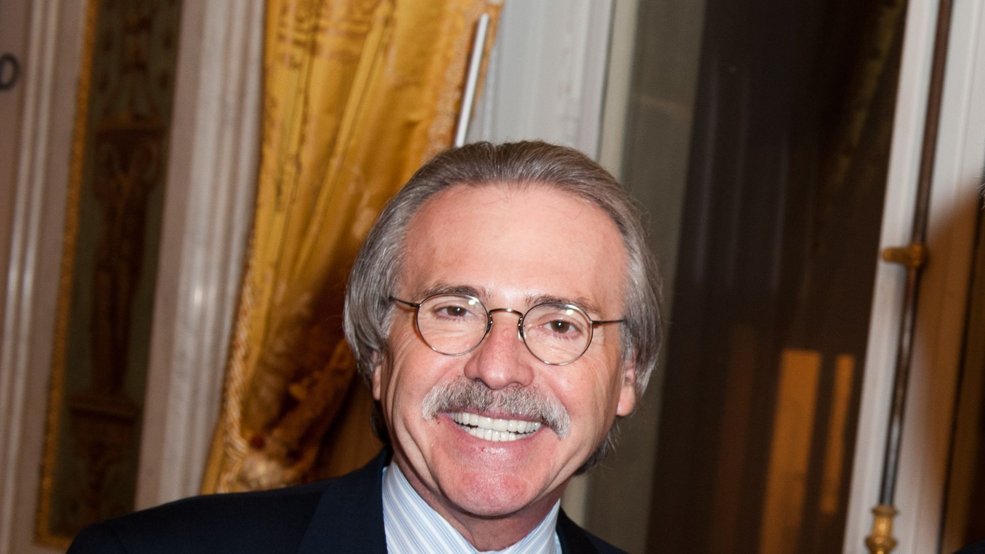 David Pecker smiles