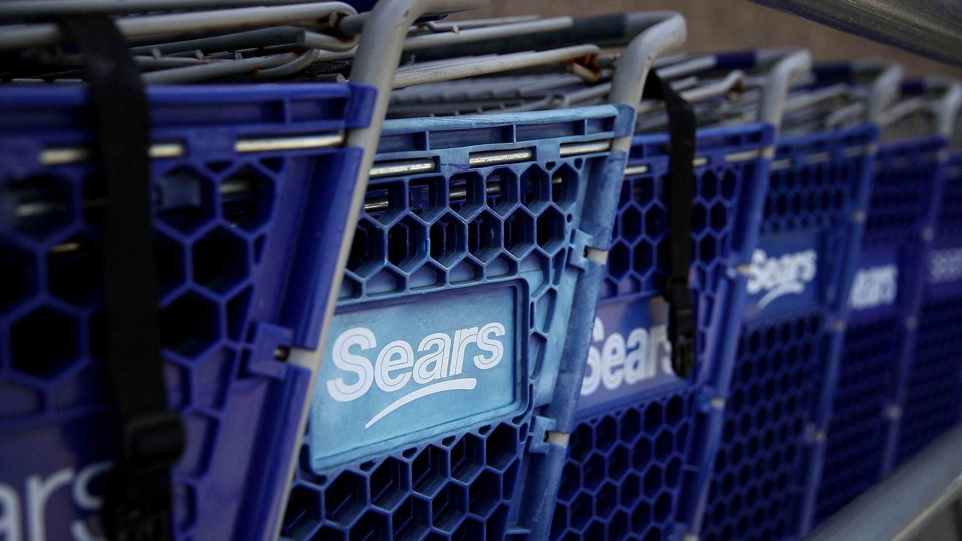 Sears logo on cart.