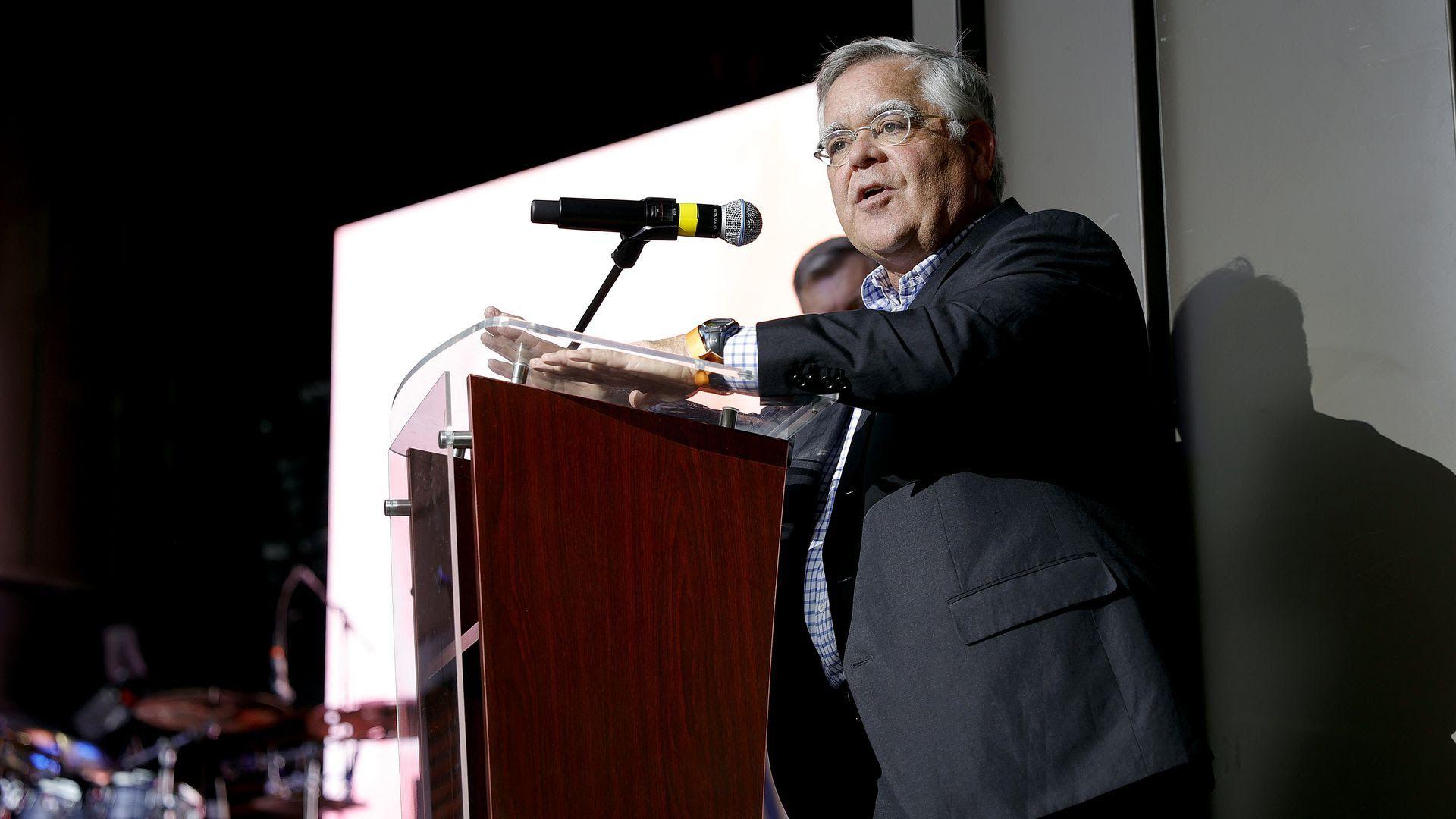 Nashville Mayor John Cooper speaks on a podium.