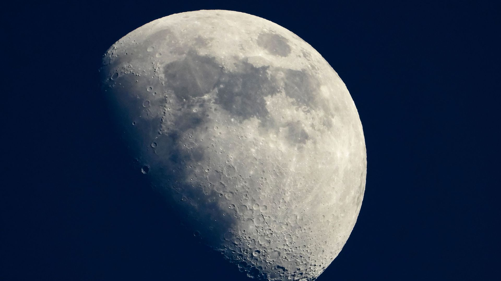 In this image, the moon is shown in a quarter full phase.