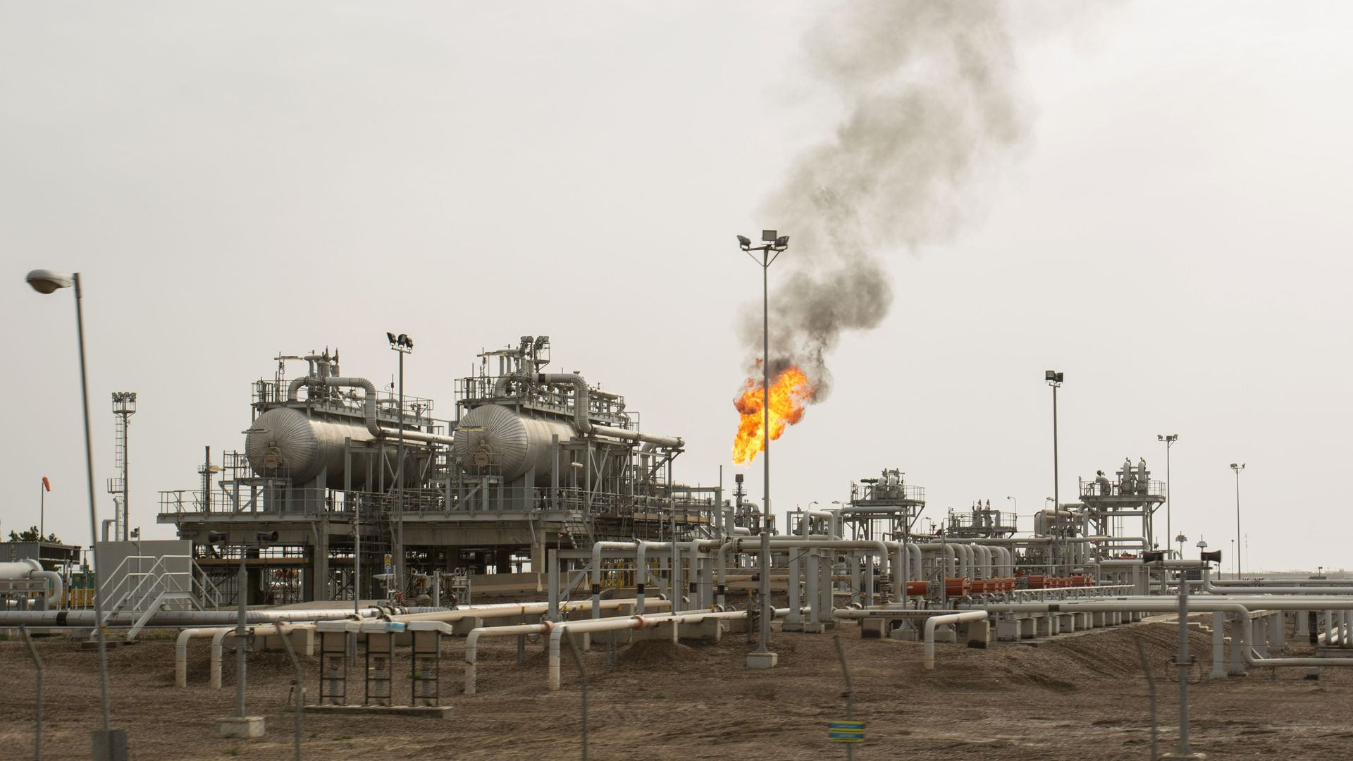 This is an image of machinery in an oil installation in a dirt field in Iraq.