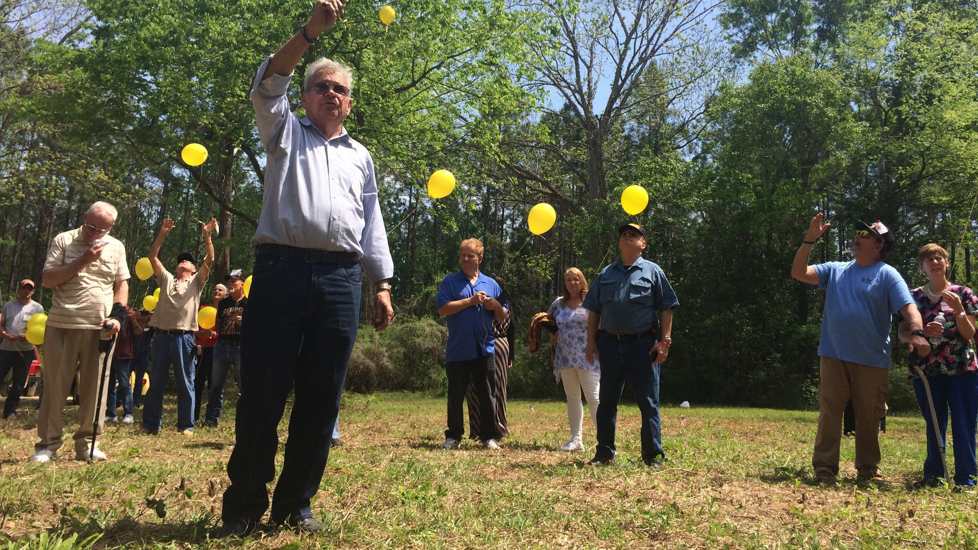 Former wards of the state who call themselves the White House Boys release yellow balloons in memory of boys who died at the state-run reform school.