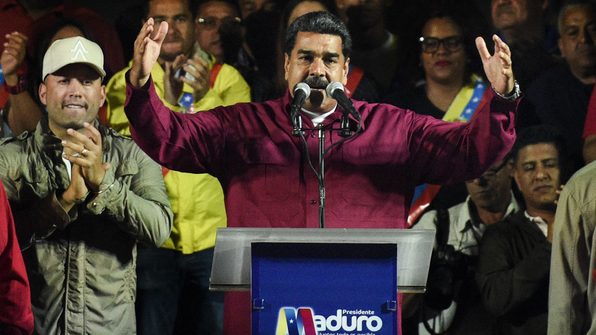 Venezuela's President, Nicolas Maduro, talks to his followers after announcing his reelection
