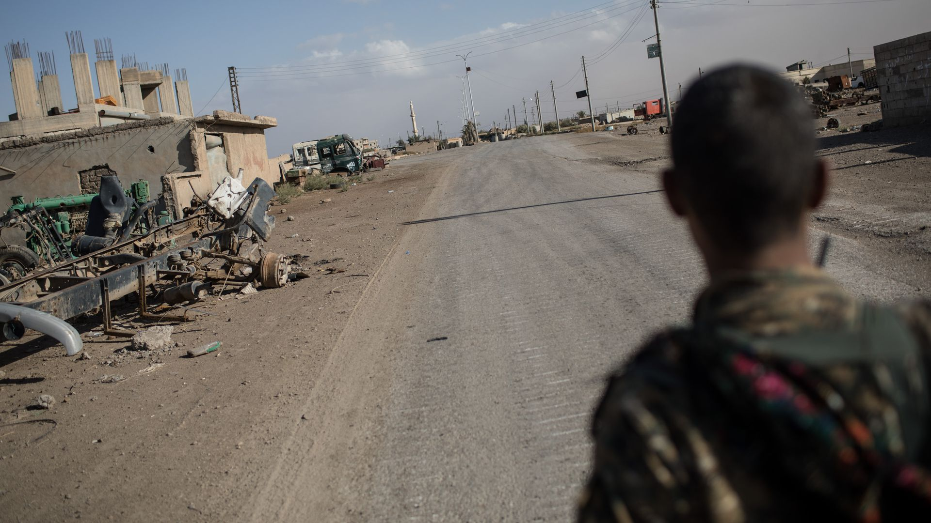 A fighter of the Syrian Democratic Forces (SDF) stands in an an empty street in the western neighborhood of Jazrah on the outskirts of Raqqa in October.