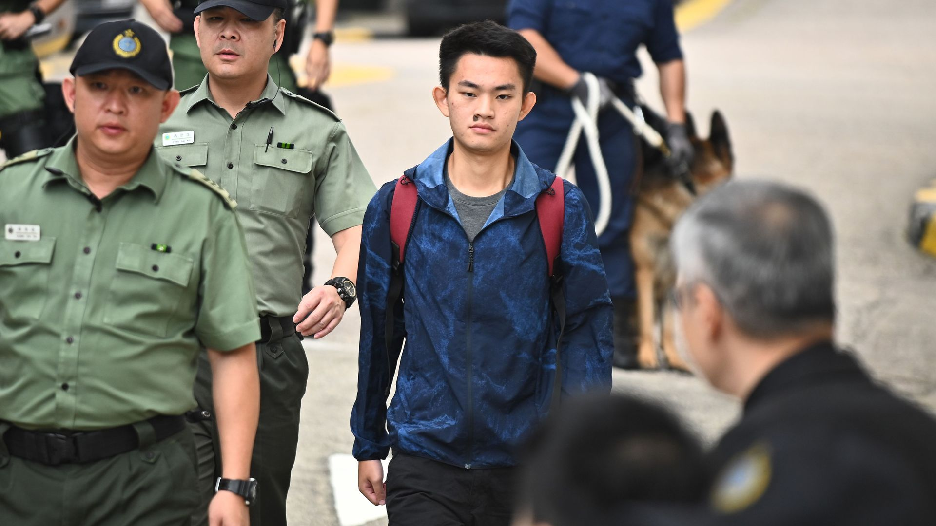 Chan Tong-kai, 20, wanted in Taiwan for the murder of his pregnant girlfriend during a holiday the two Hong Kongers took there in 2018, walks out the Pik Uk Prison in Hong Kong on October 23