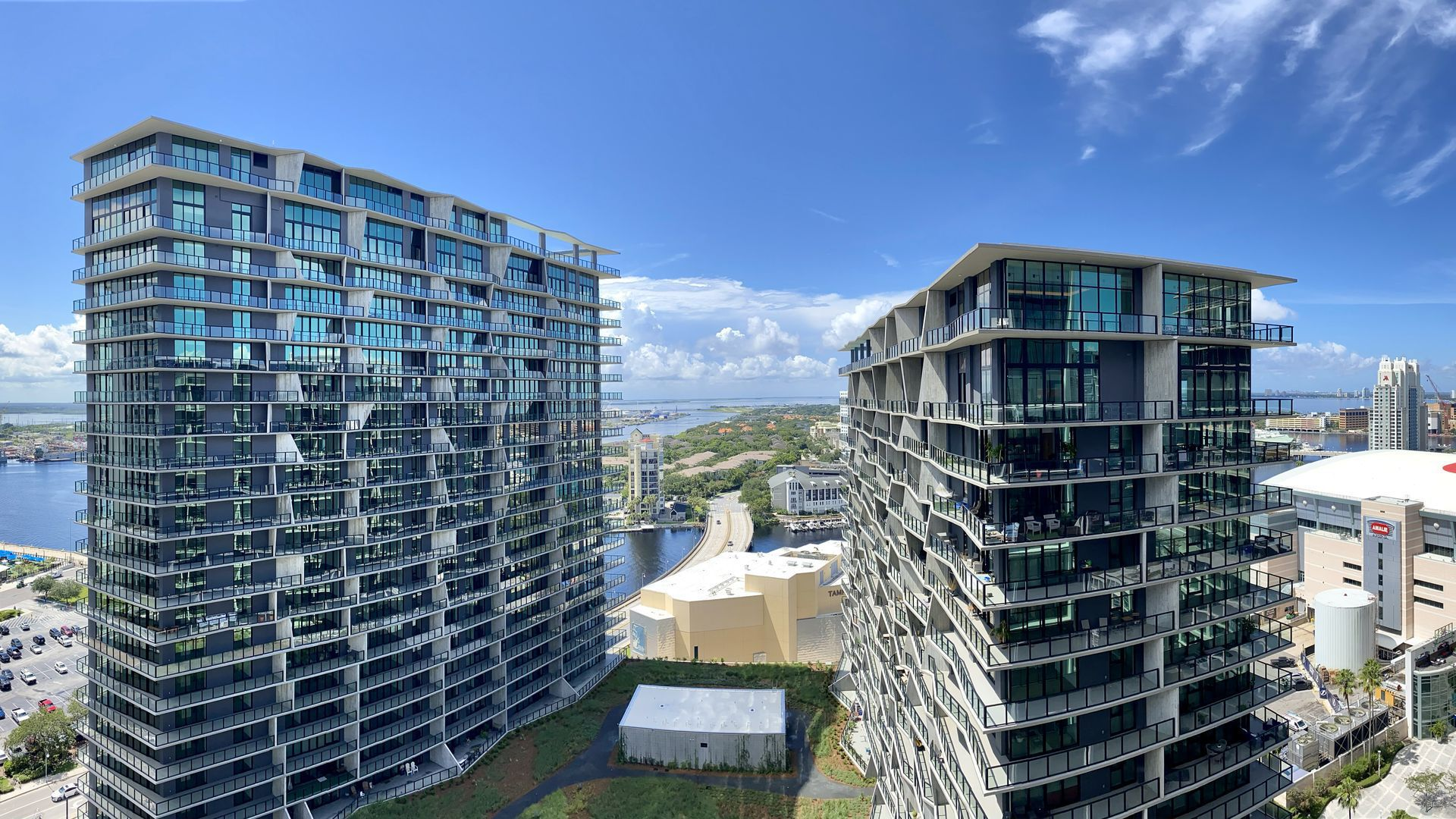 A view from Thousand & One overlooking a rooftop greenhouse and garden in Heron, a residential building.
