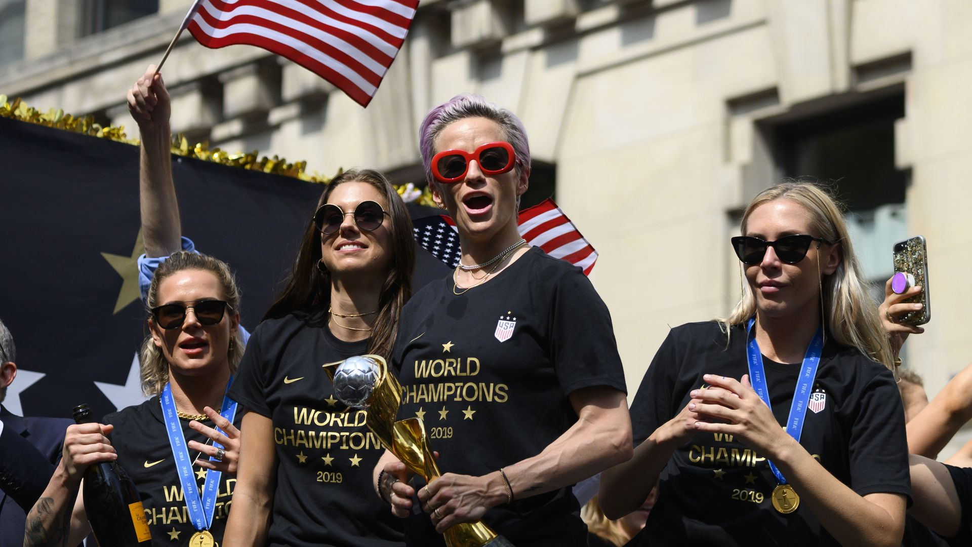 Megan Rapinoe (C) and other members of the World Cup-winning US women's team.