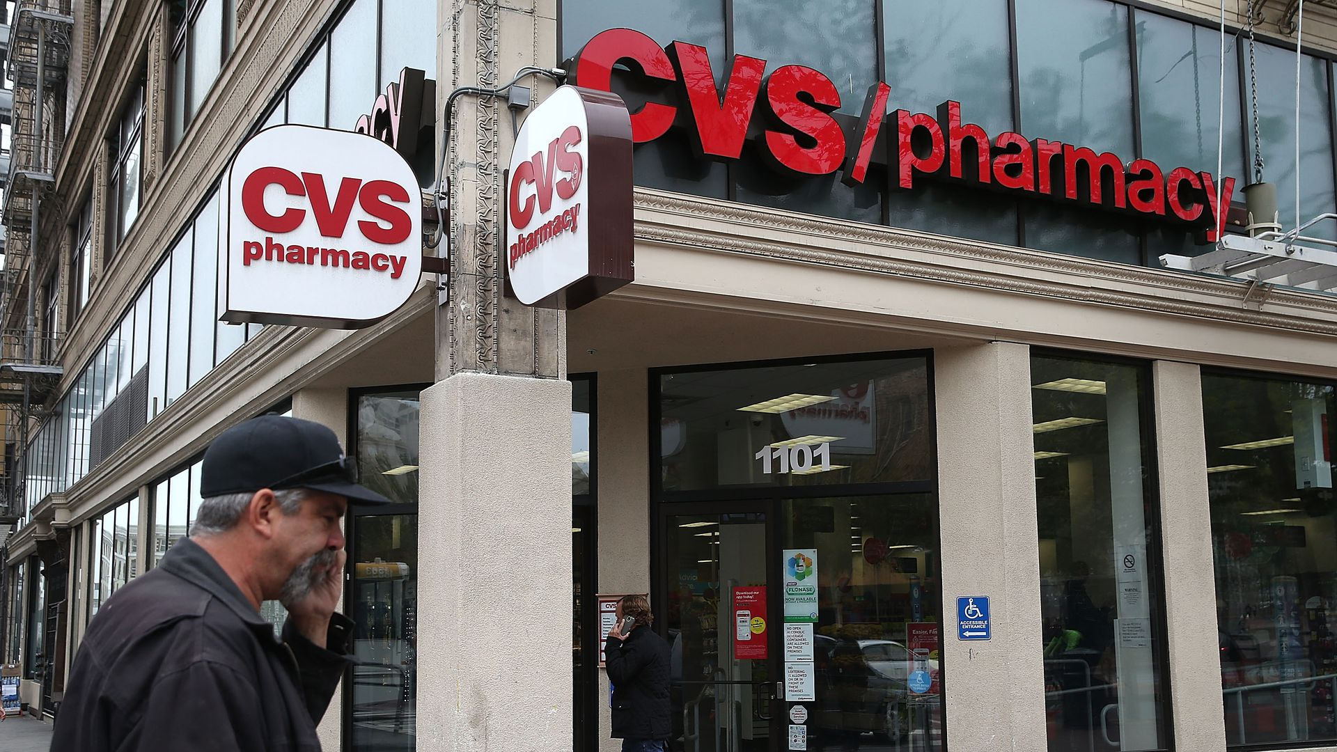 A CVS pharmacy in San Francisco with pedestrians outside.