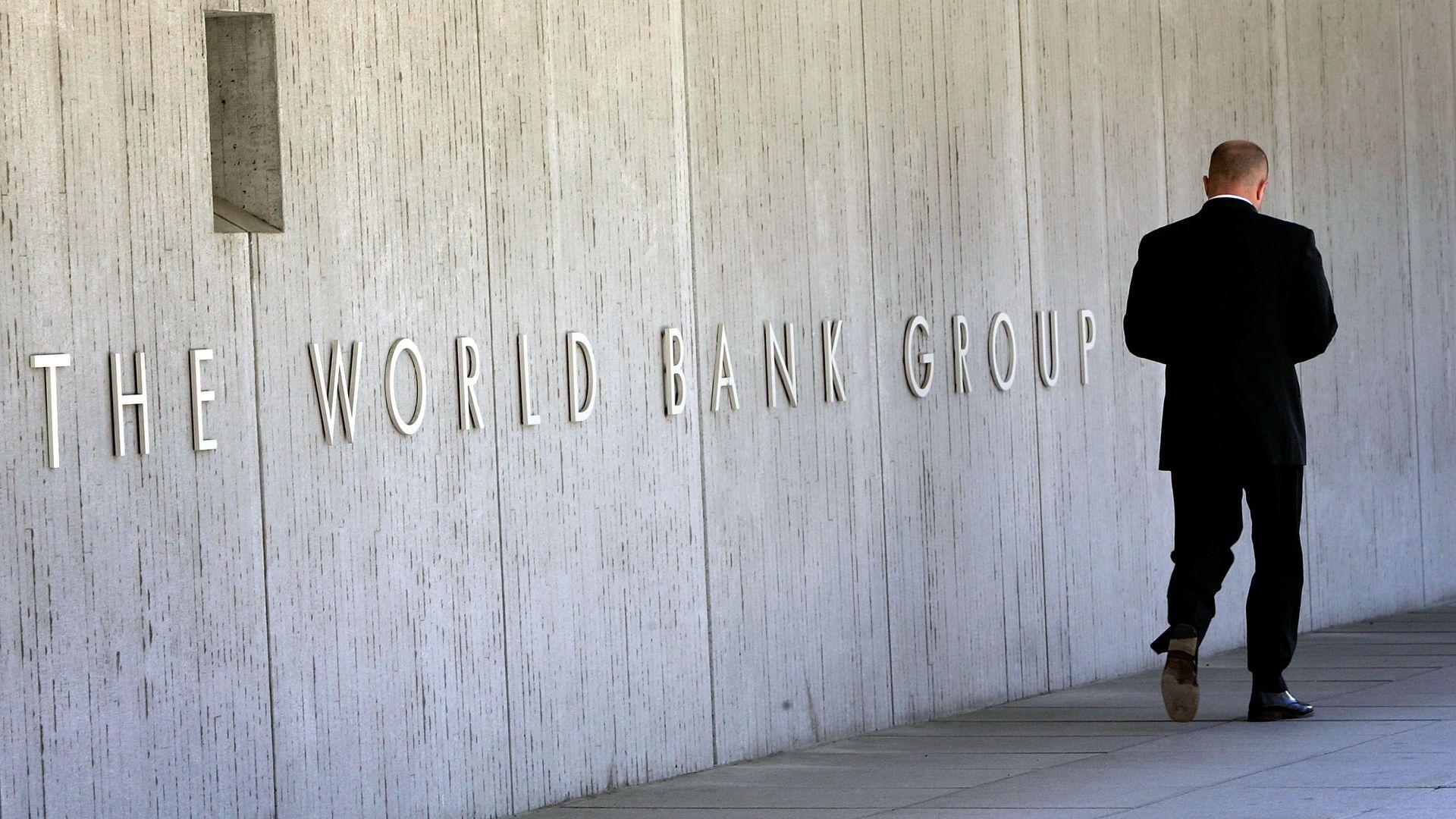An employee walks outside the World Bank headquarters May 8, 2007 in Washington, DC.