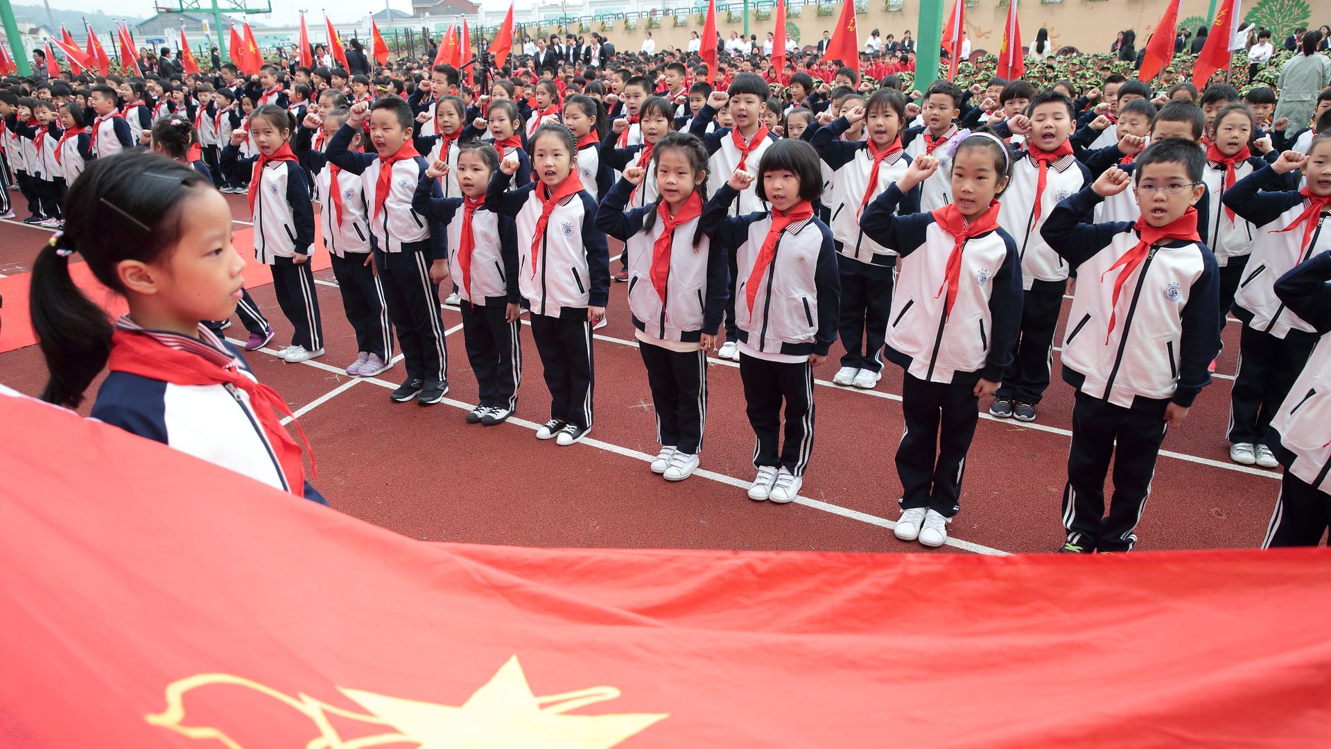 "600 young Chinese ""pioneers"" at a parade celebrating the political congress"