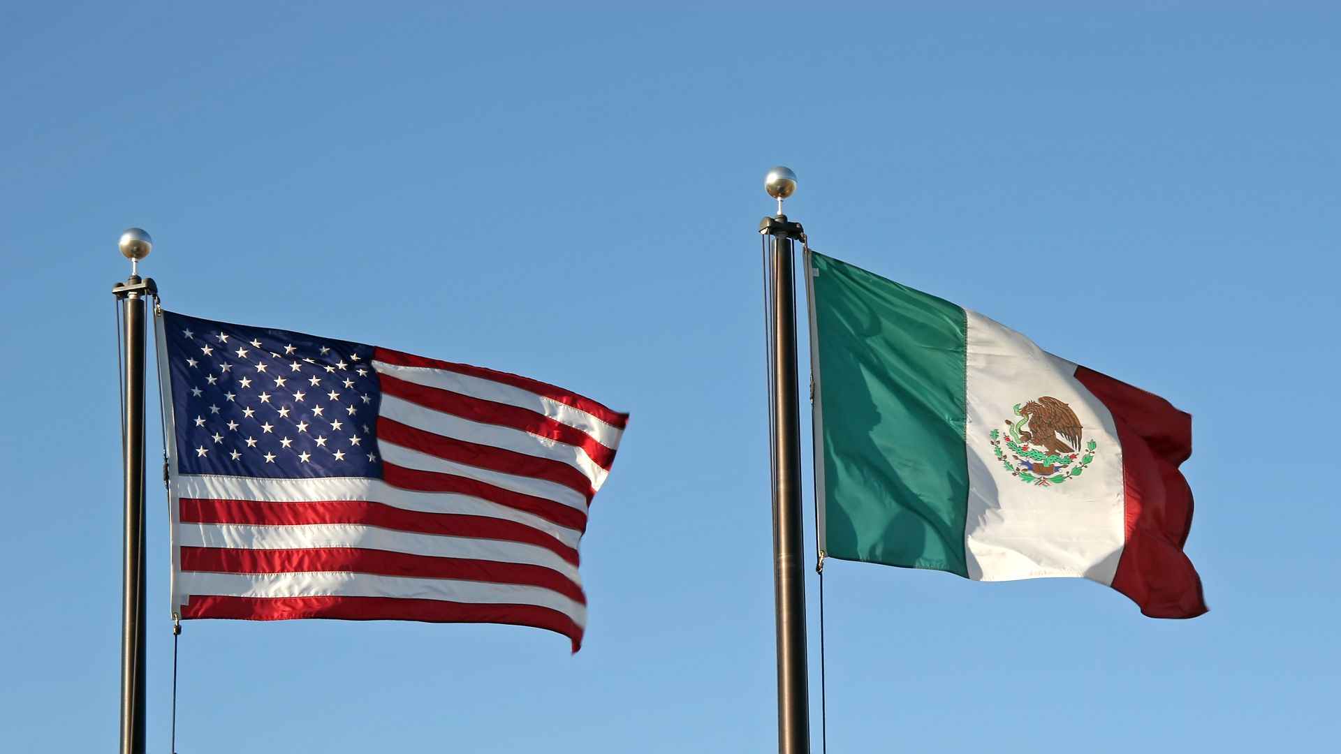 The American and Mexican flag side by side