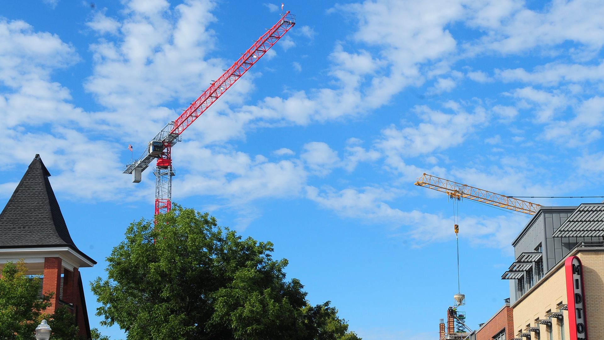Construction cranes over downtown Bentonville.