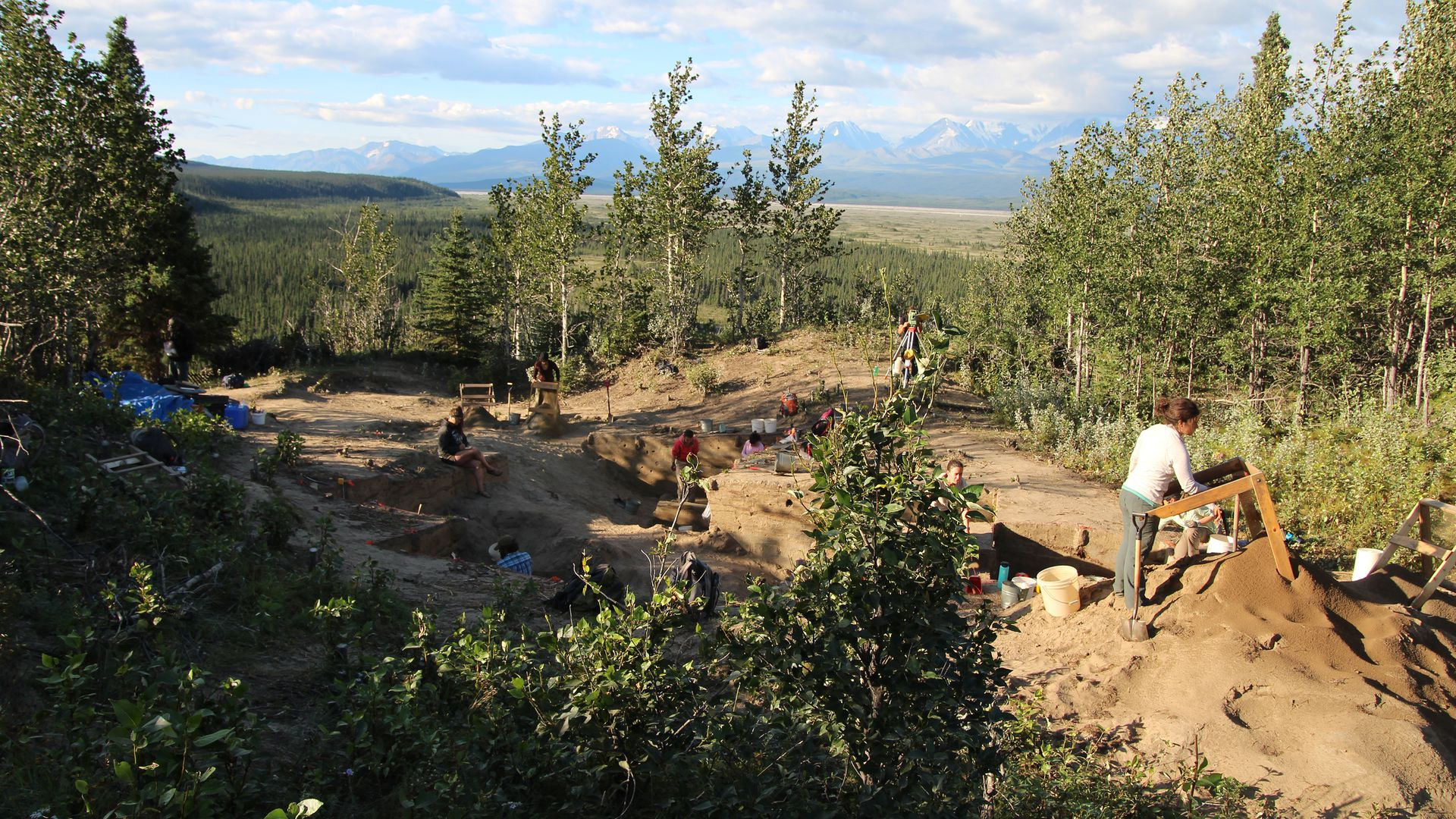 Early excavation site in Beringia with mountains in the background
