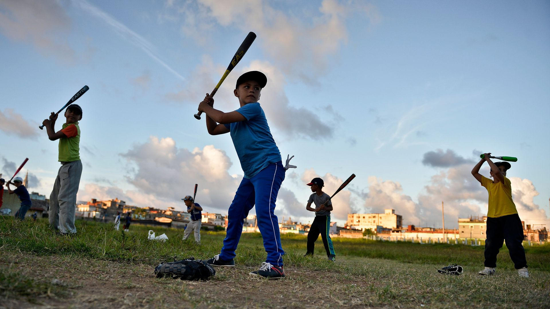 Cuban children practice baseball in a field of Havana, on September 17, 2018