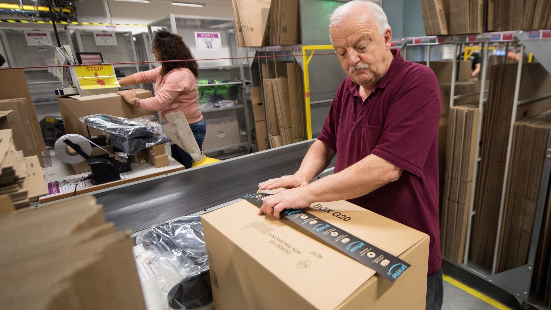 Man packaging amazon boxes.