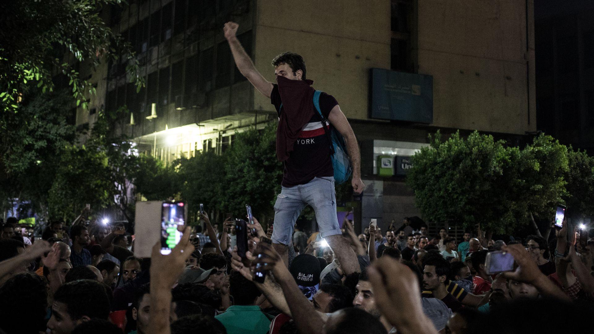 protestors in the street in Cairo