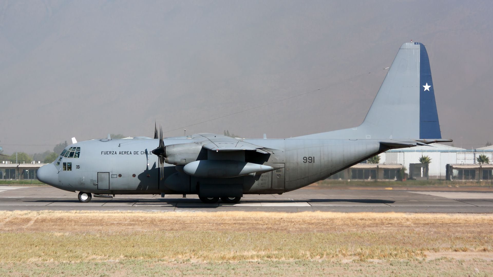 A Chile Air Force Lockheed C-130 Hercules seen ready to leave Santiago airport.