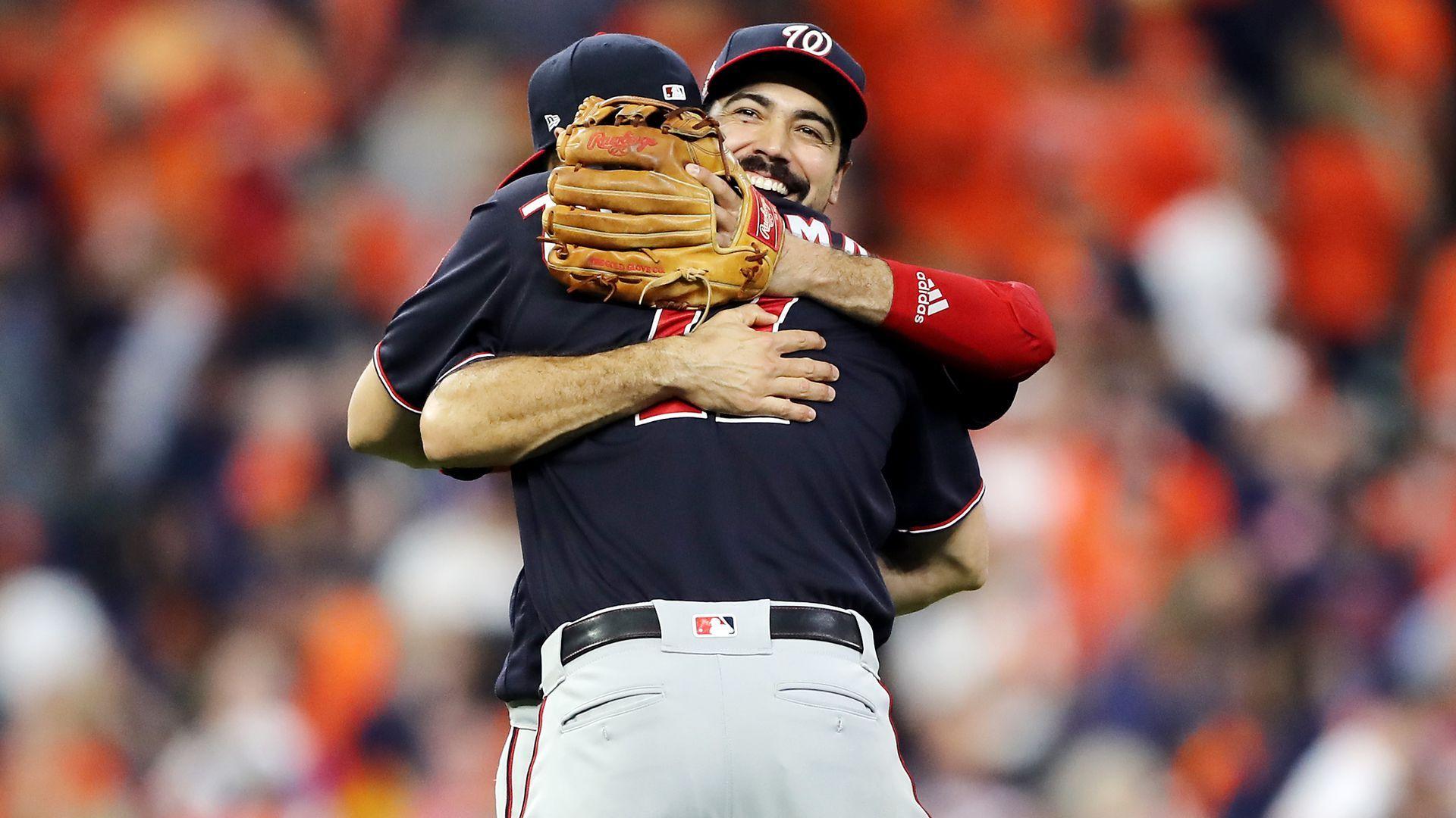 Anthony Rendon hugging Ryan Zimmerman.
