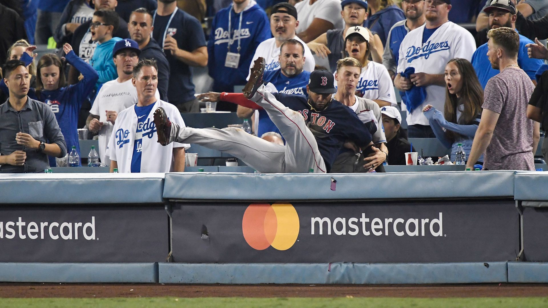 Boston mlb player falling backward into the stands.