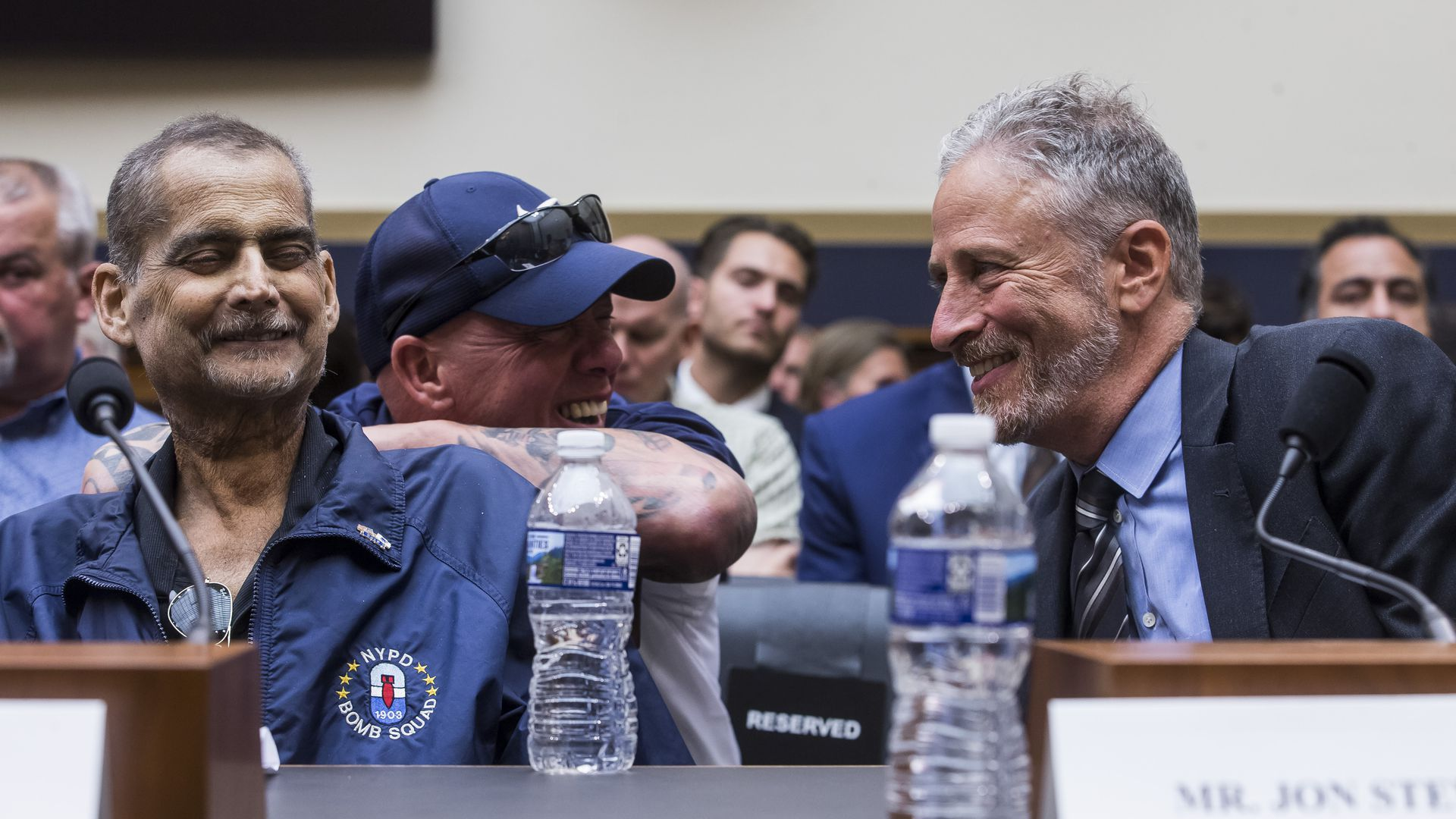 Former Daily Show host Jon Stewart speaking to a 9/11 first responder at the House Judiciary Committee meeting